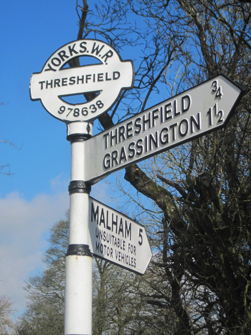 2011 March Grassington signpost with grid reference